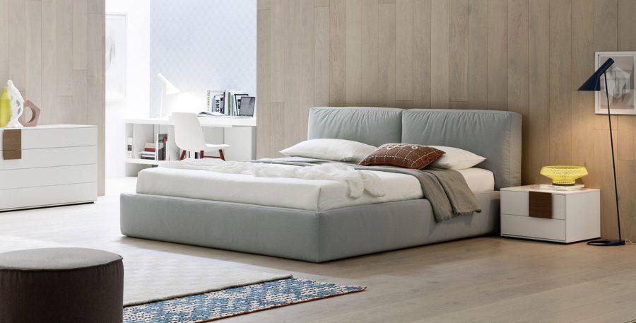 camera moderna bianco letto con contenitore